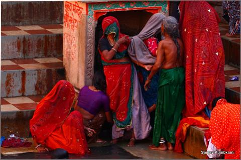Photography of old women  after their ritual Ganges dip on the ghat of Varanasi